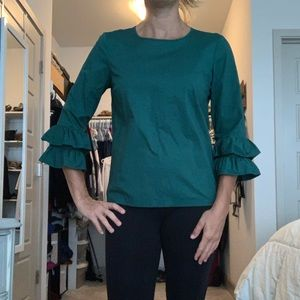 Green ruffled blouse